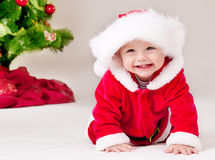 Toddler in Santa costume Stock Photos