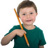 Toddler Schoolage Child Holding Large Pencil. Royalty Free Stock Photos
