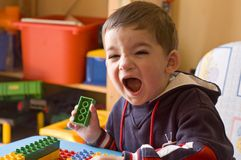 Toddler screaming in his room. Child screaming portrait Stock Image