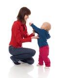 Toddler sharing toy Royalty Free Stock Photos
