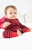 Toddler Sitting On Bed Wearing Pajamas Stock Photography