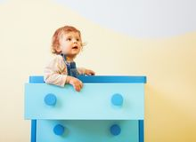 Toddler sitting in the box Stock Photos