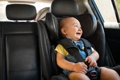 Toddler sitting in car during road trip royalty free stock photos