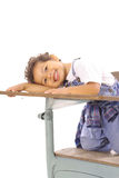 Toddler sitting in a desk isolated vertical Stock Photography