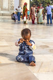 Toddler sitting in front of the Taj Mahal in India Stock Photography
