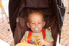 Toddler sitting in his pushchair Stock Image