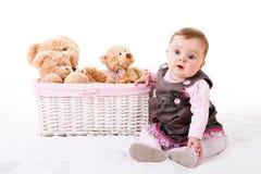 Toddler Sitting Next To Teddy Bears Royalty Free Stock Photos