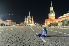 Toddler sitting on the Red Square in Moscow Royalty Free Stock Images