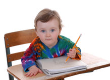 Toddler Sitting At School Desk Stock Photos