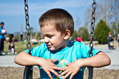 Toddler Sitting on Swing Stock Photo