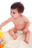 Toddler sitting with toys Royalty Free Stock Photo