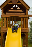 Toddler Sitting in a Tree House ready to S. Photo of a Toddler Sitting in a Tree House ready to Slide stock images