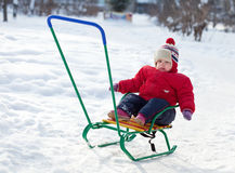 Toddler on sled  in winter Stock Images
