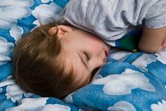 Toddler Sleeping. On Blue Cloud Comforter Royalty Free Stock Image