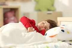 Toddler sleeping in a bed royalty free stock photos