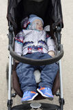 Toddler sleeping in stroller Stock Photography