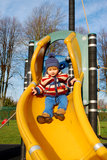 Toddler on slide. Toddler having fun on the slide Stock Image