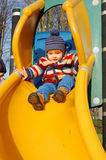 Toddler on slide. Toddler having fun on the slide Stock Photography