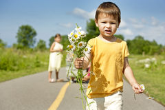 Toddler smelling flower Royalty Free Stock Photos