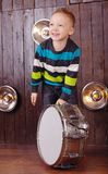 Little boy plays the drum. stock images