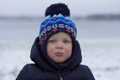 Toddler with snivel and red cheeks. Outdoor winter shot.  Royalty Free Stock Photo