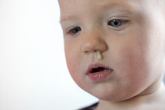 Toddler with snot hanging out of nose Stock Photos