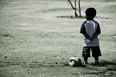 Toddler with soccer ball and hands on back Royalty Free Stock Images