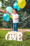 Toddler Standing on Wooden Crate stock photos
