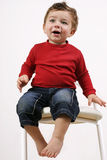 Toddler on stool (2) royalty free stock photography