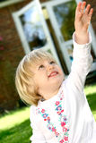 Toddler stretching her arm Royalty Free Stock Image