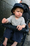 Toddler in stroller. Young boy riding in a stroller Royalty Free Stock Photography