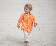 Toddler strolling the beach Royalty Free Stock Images
