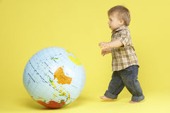 Toddler In Studio With Globe Stock Photos