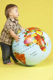 Toddler In Studio With Globe Royalty Free Stock Image