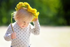 Toddler at the summer day. Toddler playing at the spring or summer day Royalty Free Stock Images