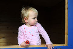 Toddler in summerhouse Stock Image