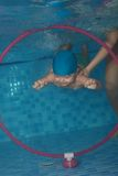 Toddler swimming exercises Royalty Free Stock Images