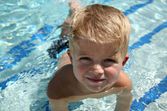 Toddler Swimming Lesson. Smiling Toddler at a Swim Lesson Royalty Free Stock Images