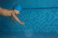 Toddler swimming in the pool Royalty Free Stock Photography