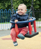 Toddler on swing Royalty Free Stock Image