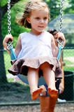 Toddler on swing Stock Images