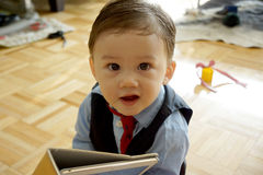 Toddler with a Tablet in Business Attire. Toddler with business attire ready to go to work Stock Images