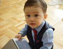 Toddler with a Tablet in Business Attire. Toddler with business attire ready to go to work Stock Photos