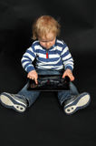 Toddler with tablet pc Stock Images