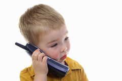 Toddler talking on the phone Stock Photo