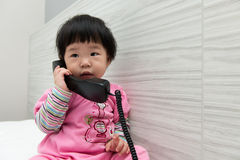 Toddler talking on the phone Royalty Free Stock Image