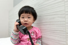 Toddler talking on the phone Stock Images