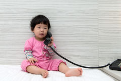 Toddler talking on the phone Stock Photography