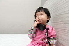 Toddler talking on the phone Royalty Free Stock Images