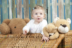 Toddler with teddy bears standing in a trunk Royalty Free Stock Images